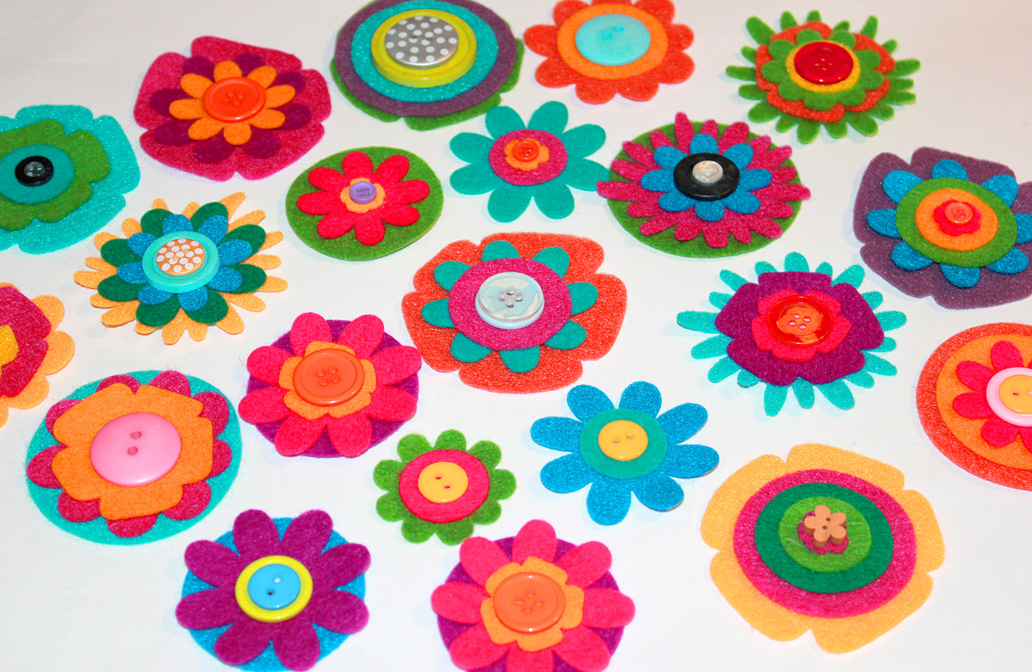 Finish the center of each flower by gluing on a colorful button, or layering two different sized buttons to create even more dimension.
