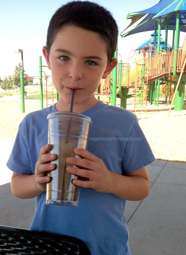 Kid Drinking Iced Tea