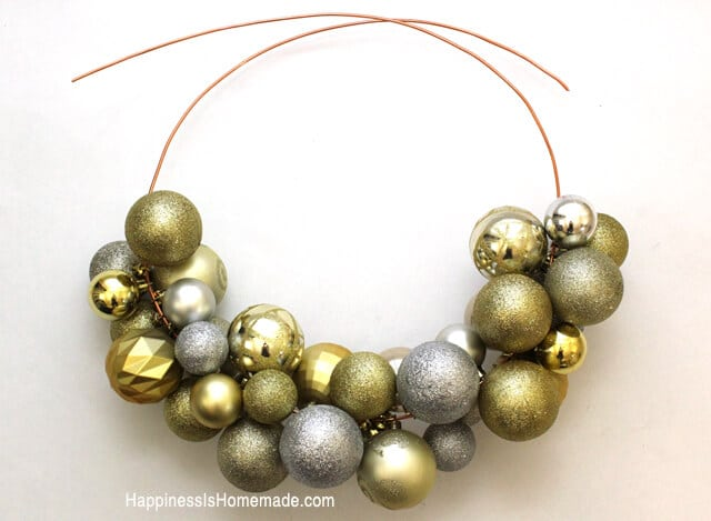 Diy christmas ornament wreath tutorial happiness is homemade stringing an ornament wreath is so simple solutioingenieria Gallery