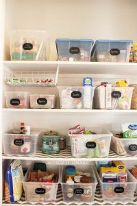 Organized Pantry Shelves with Bins and Chalkboard Labels
