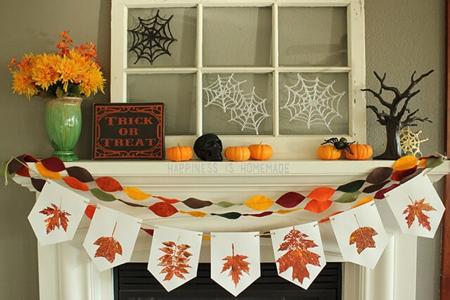 Glitter Glue Spiderwebs on Fall Halloween Mantel