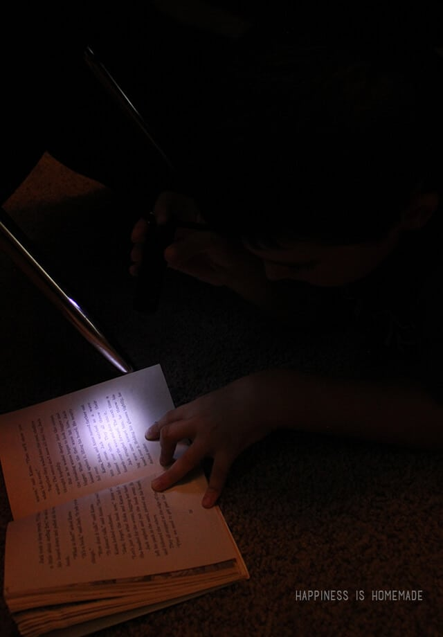 Reading in the Fort by Flashlight