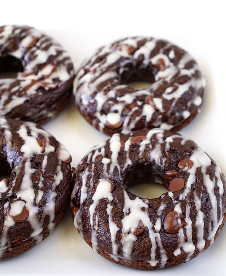 Healthy (Healthier) Chocolate Donuts are Under 100 Calories - These better-for-you double chocolate donuts are under 100 calories each! A moist and rich chocolaty indulgence that won't blow your diet!