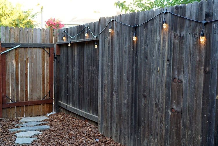 Enbrighten Cafe Lights Along a Fence