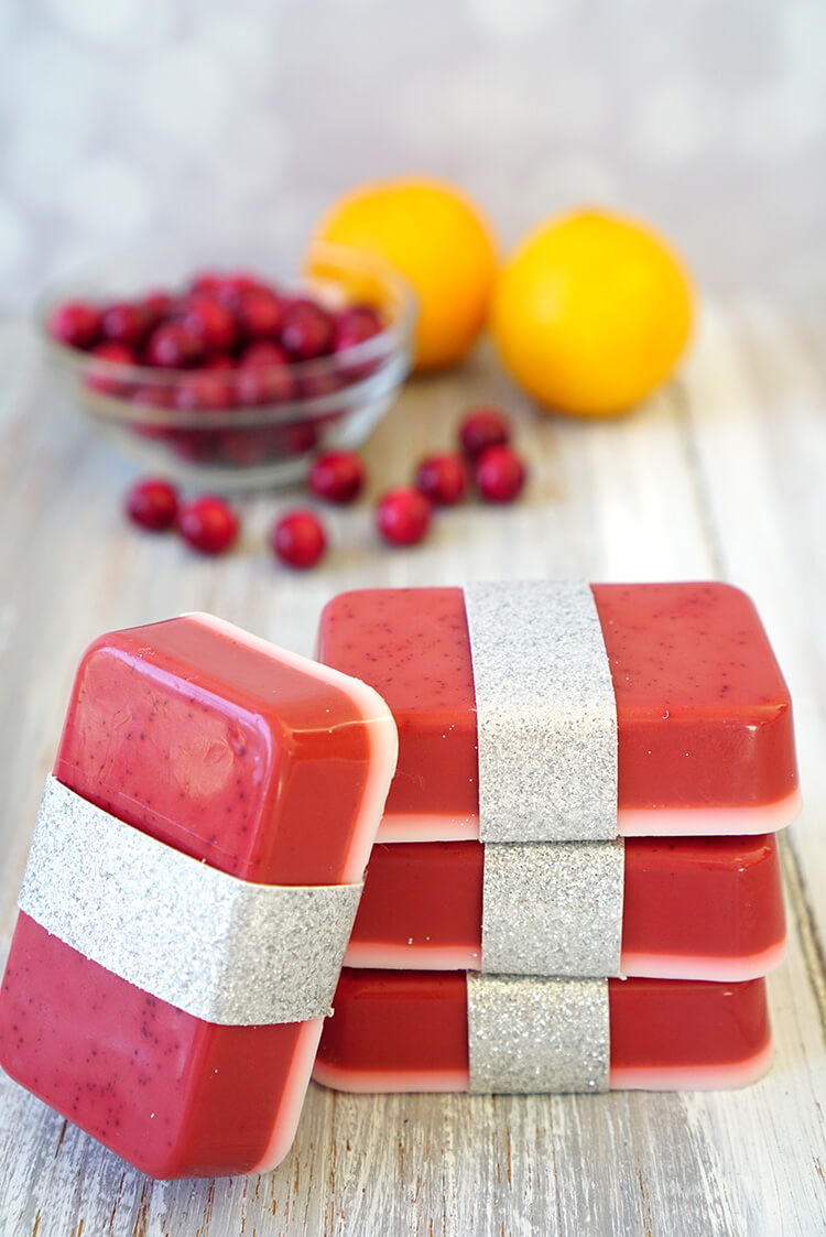 This Cranberry Orange Soap smells delicious, and you can whip up a batch in just a few minutes! Makes a great quick and easy DIY homemade holiday gift idea that's perfect for friends, family, neighbors, and teachers!