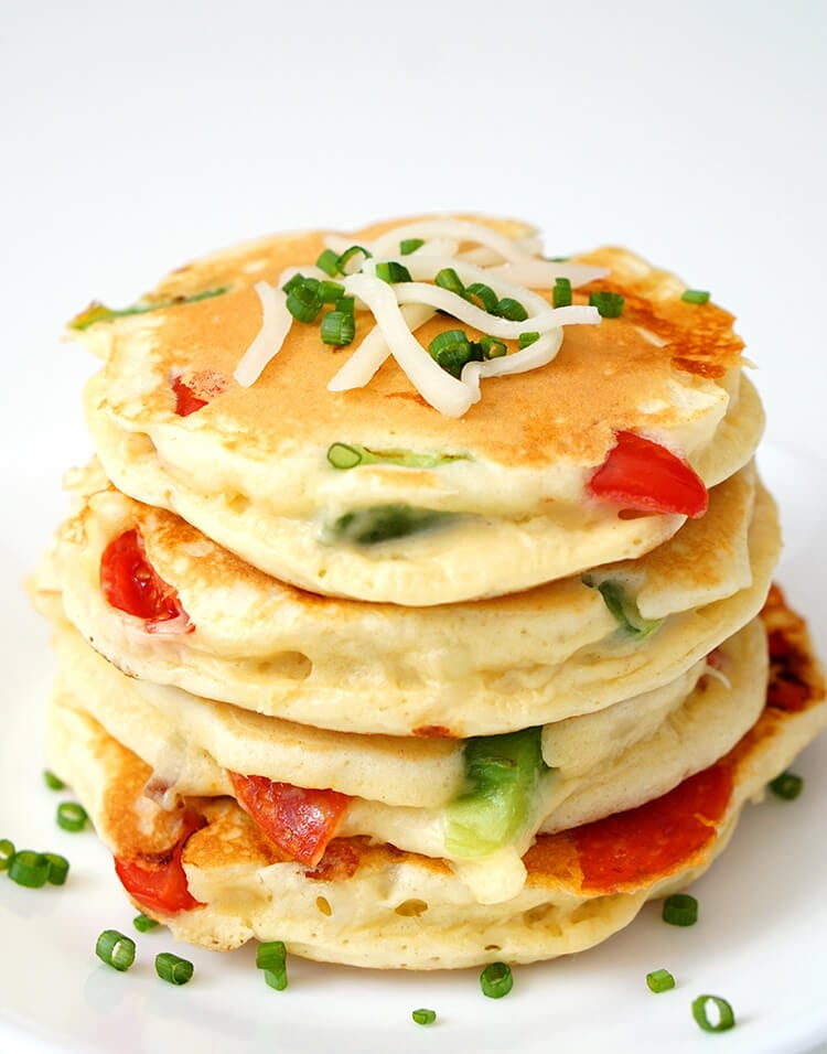 Pizza Pancakes are a quick and easy dinner idea that your whole family will love! Personalize them with your favorite pizza toppings for a delicious family dinner in under 30 minutes!
