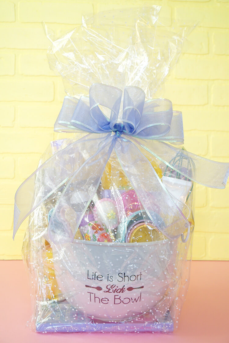 Easter baking gift basket happiness is homemade i repeated the process with the other sheet of cellophane and used double stick tape to hold down any loose seams in the wrapping negle Images