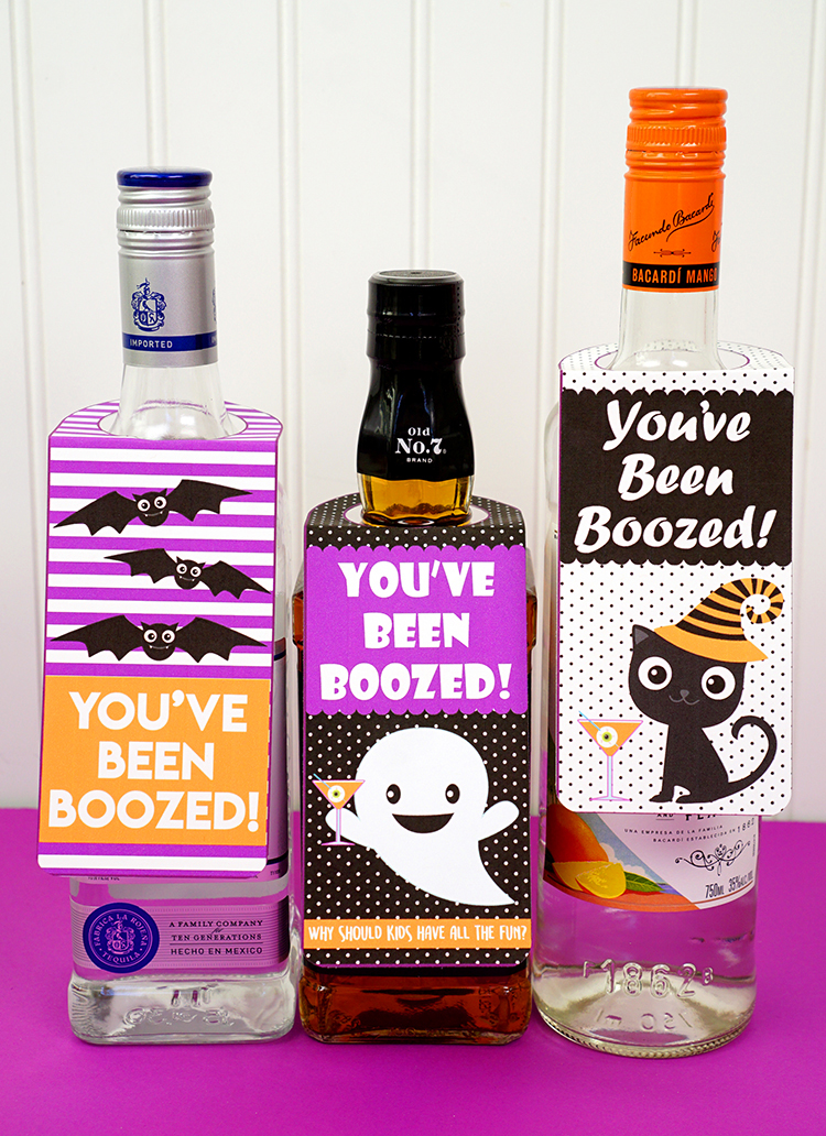 "These awesome ""You've Been Boozed!"" printable bottle gift tags are a fun adult Halloween treat for the grown-ups! Why should kids get to have all the fun?!"