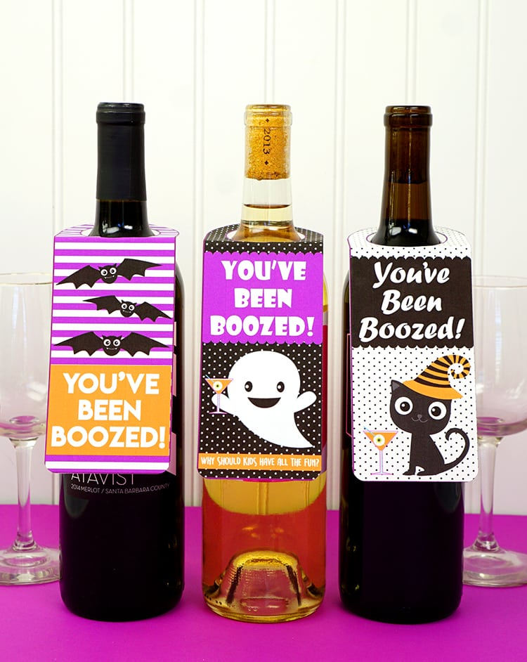 "Check out these awesome ""You've Been Boozed!"" printables for the grown-ups! Deliver these cute bottle gift tags along with a bottle of wine or liquor to your most deserving adult friends for a fun Halloween treat! Why should kids get to have all the fun?!"