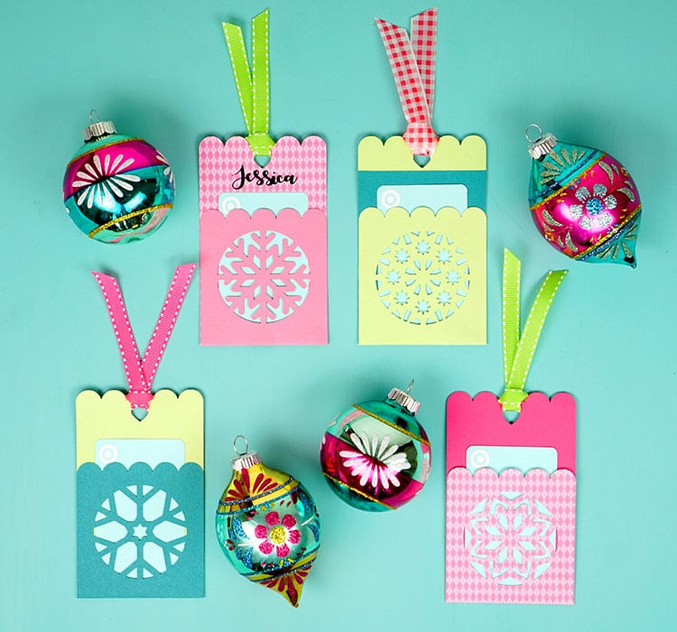 Make these quick and easy Snowflake Gift Card Holder Tags to make gift giving simple! All you need is paper, glue, ribbon, and our SVG file!