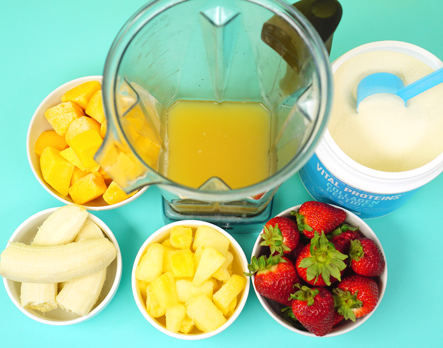 Making a Tropical Smoothie with Bowls of Fresh Fruit