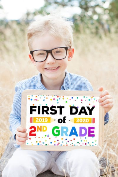 Free Printable Back to School Signs - cute boy in glasses holding