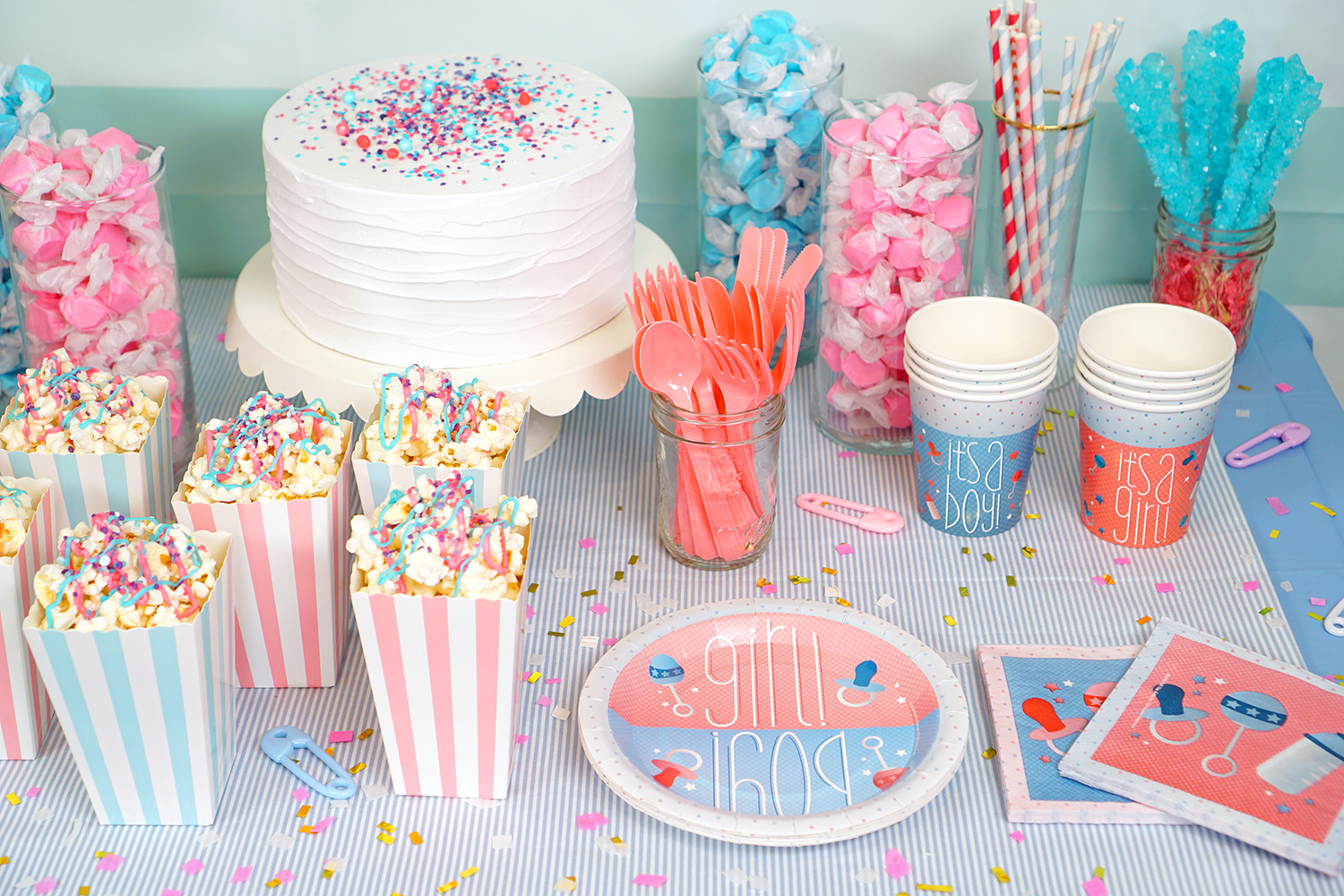 Gender reveal party table and paper party supplies