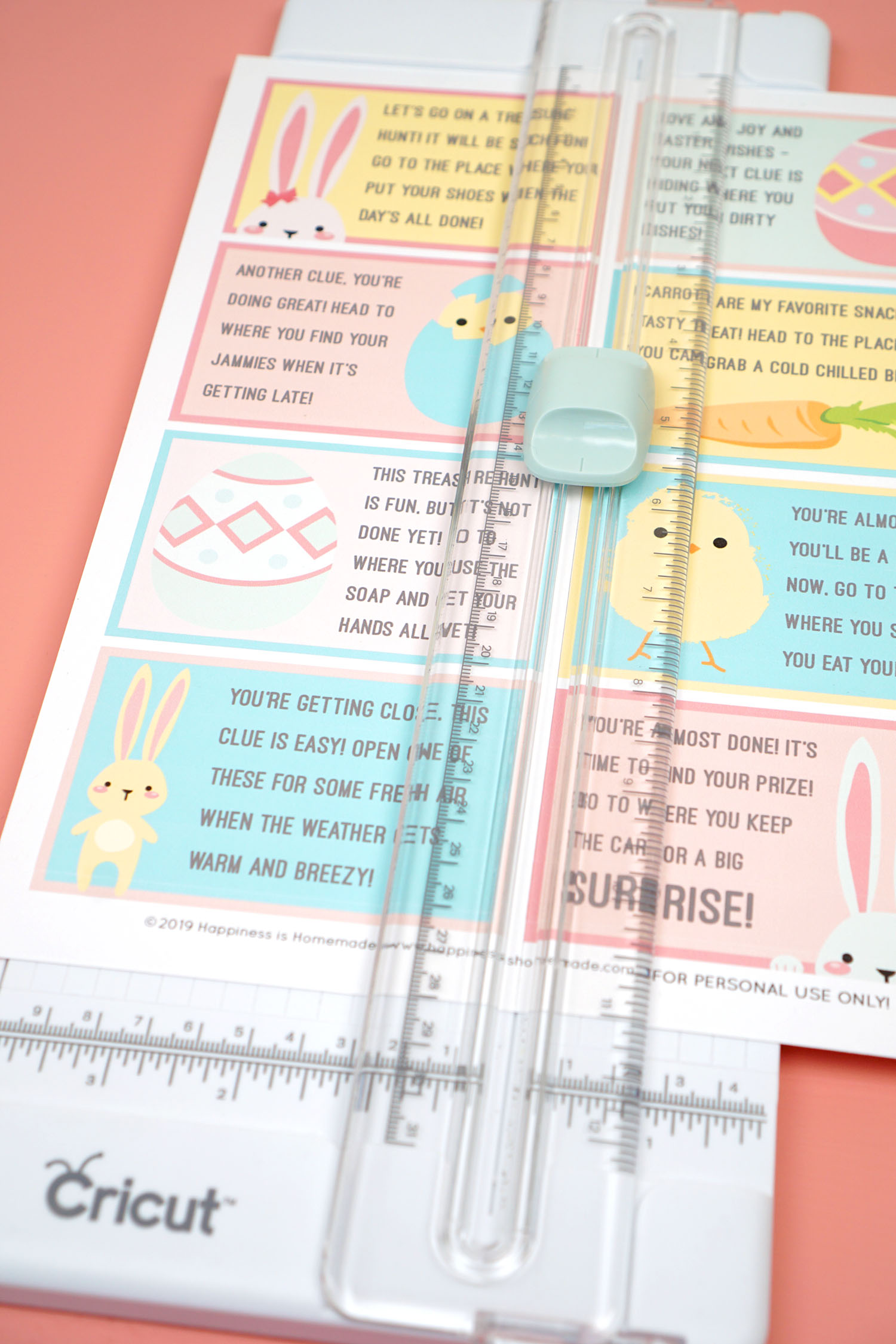 Easter Scavenger Hunt Cards being cut on the Cricut Paper Trimmer