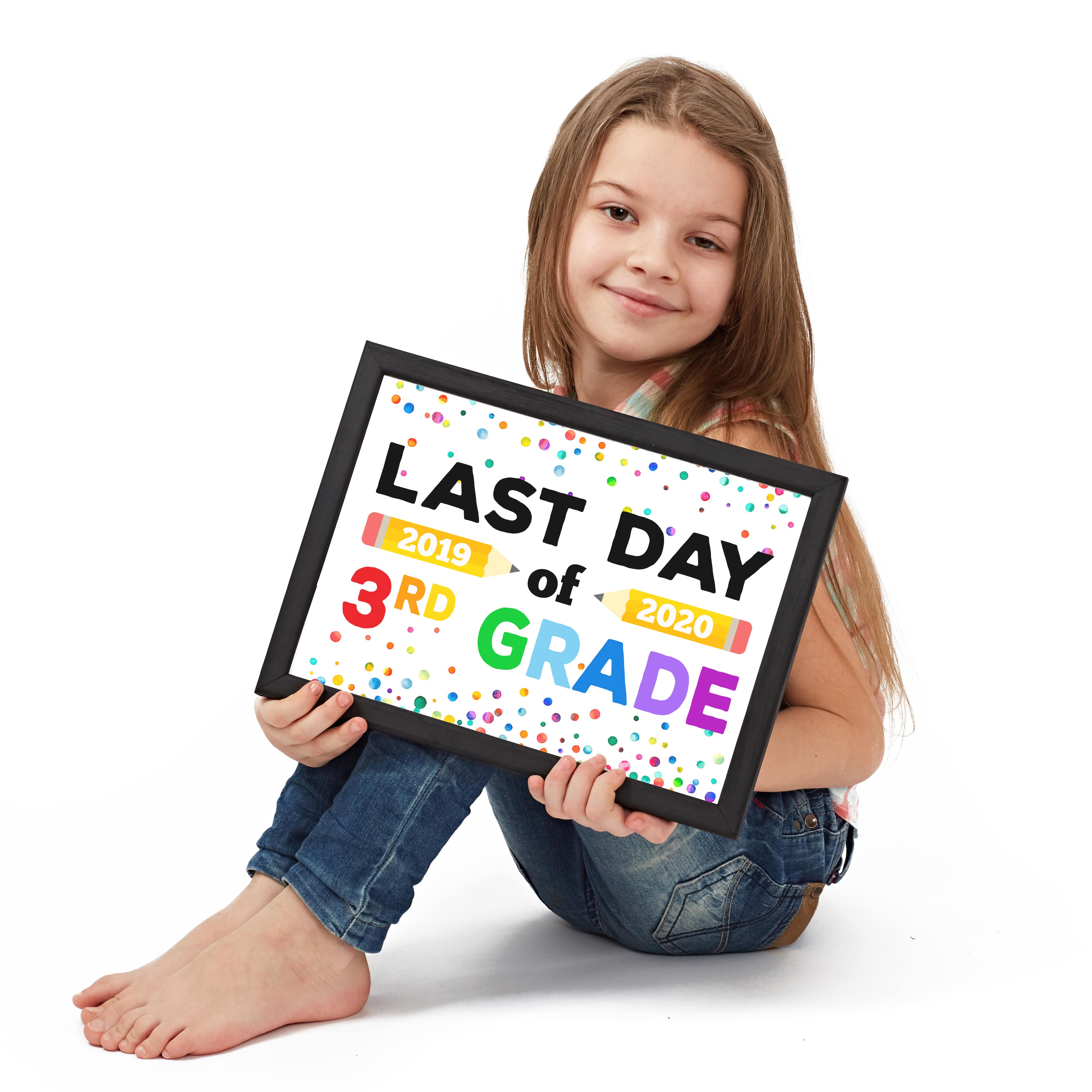 Cute girl holding Last Day of School Sign