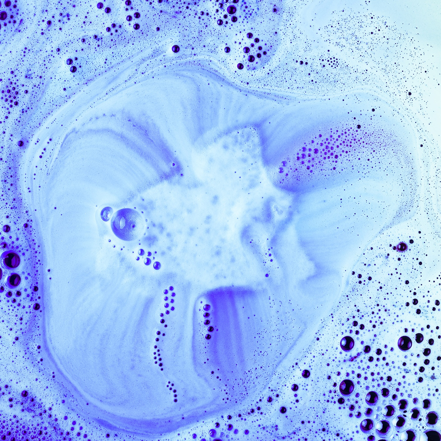 blue bath bomb fizzing in bath tub water