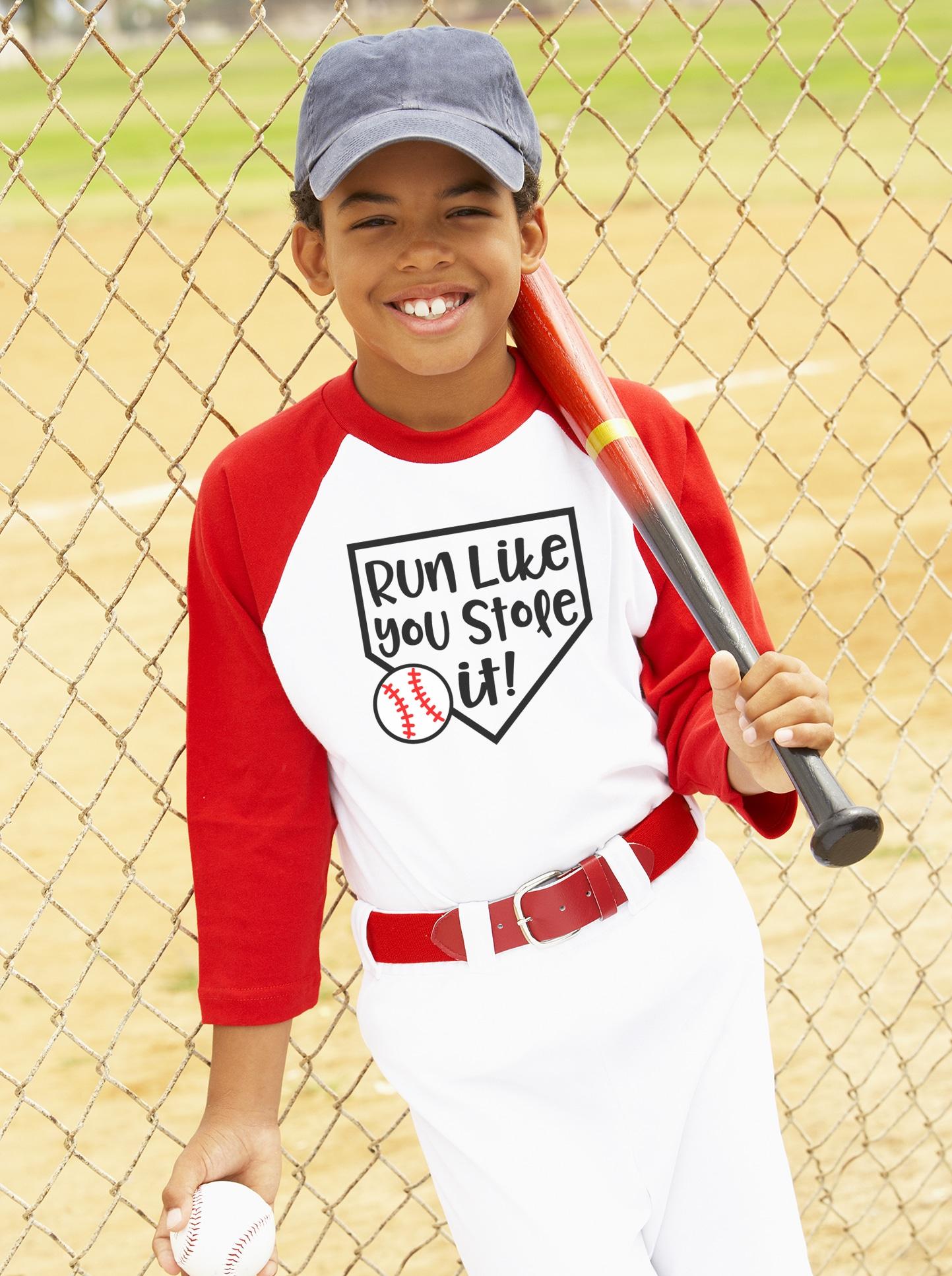 Boy wearing a Run Like You Stole It! baseball shirt