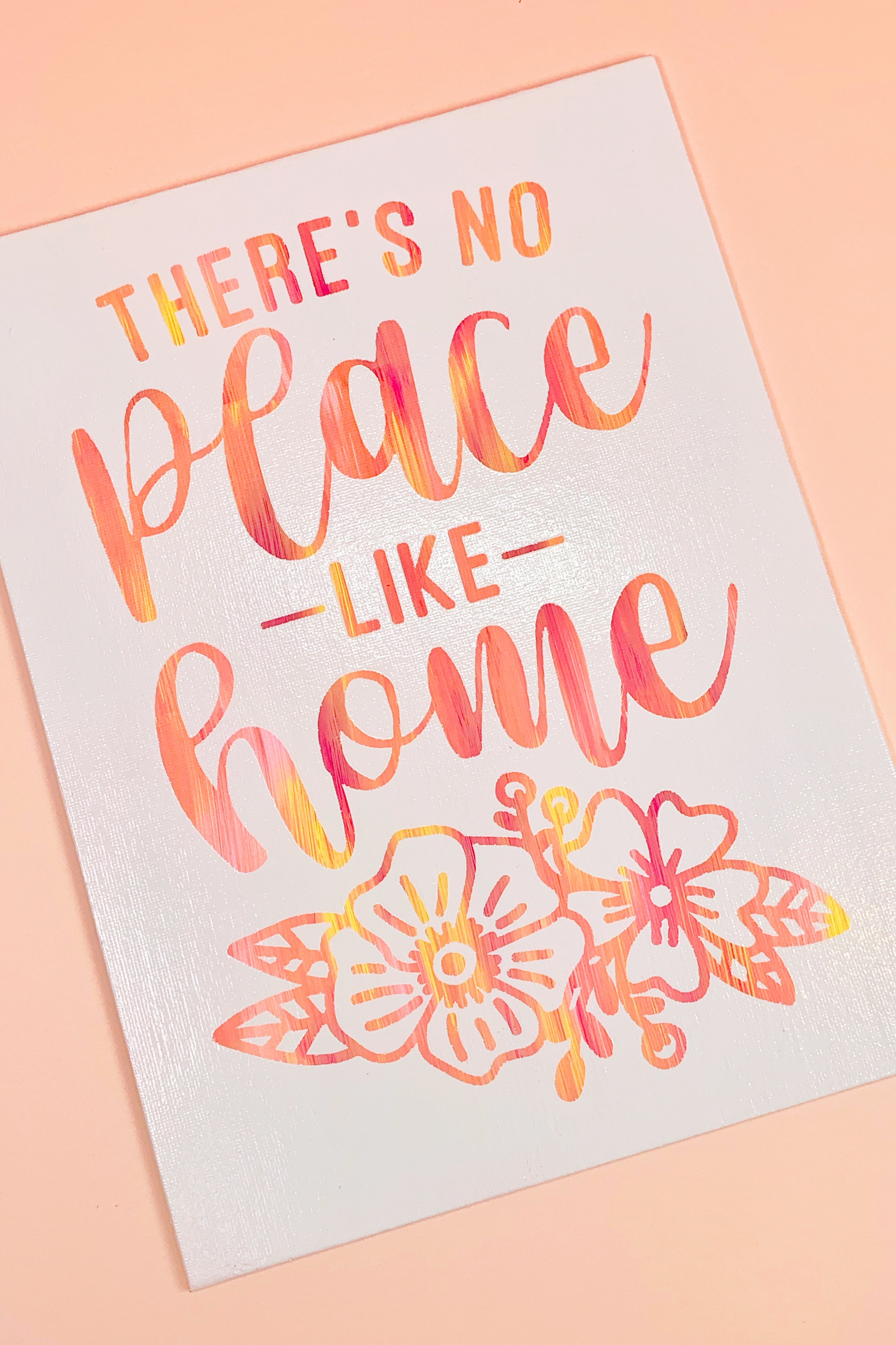 "Completed white hot mess canvas with sunset-hued ""There's No Place Like Home"" quote"