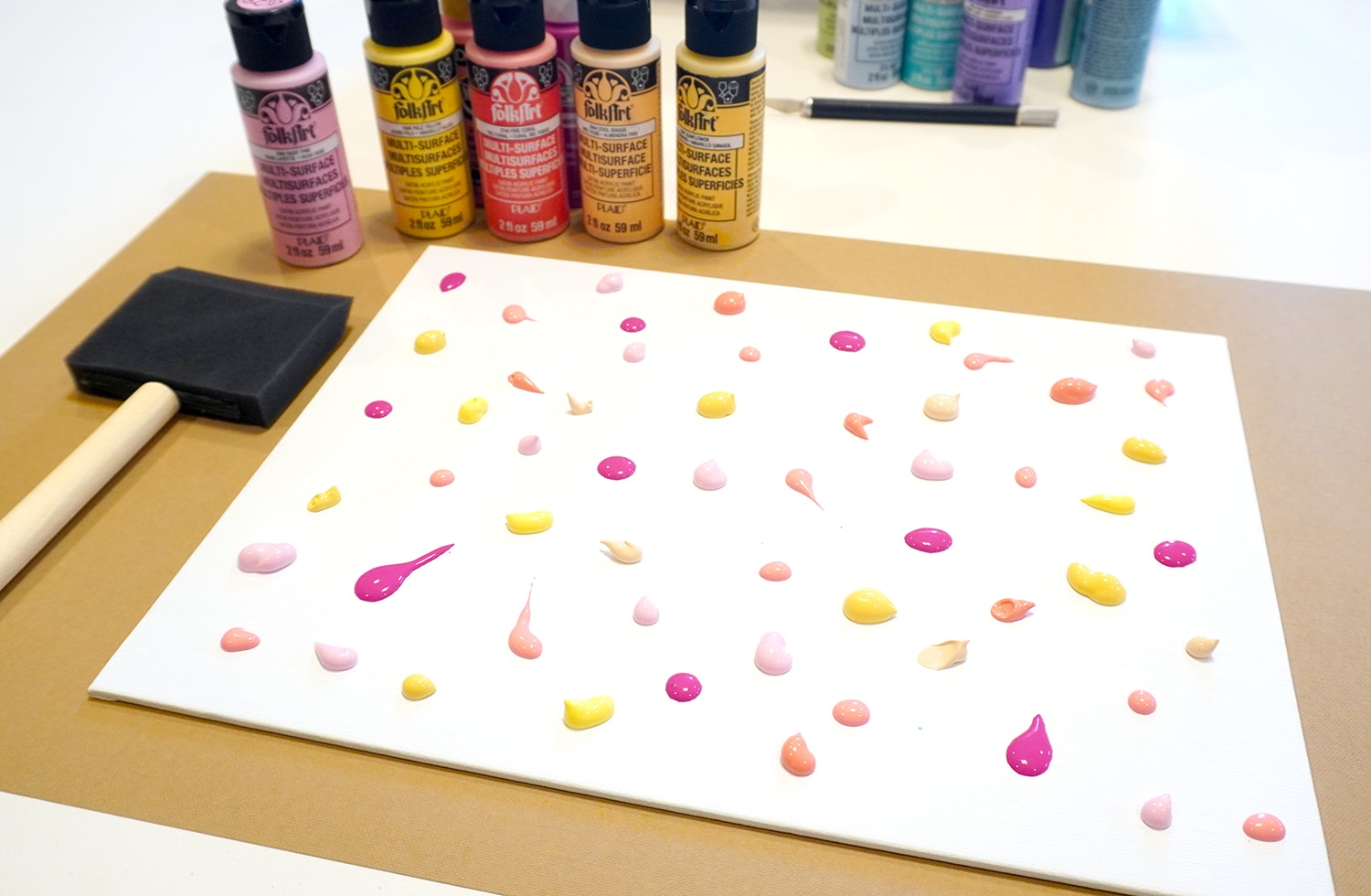 Colorful acrylic paint drops and blobs on canvas