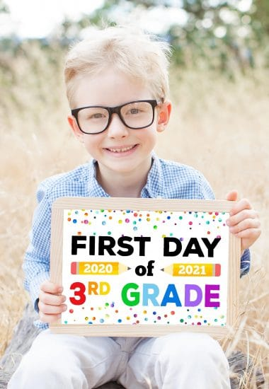 "Cute boy in glasses with printable ""First Day of School 2020-21"" sign"