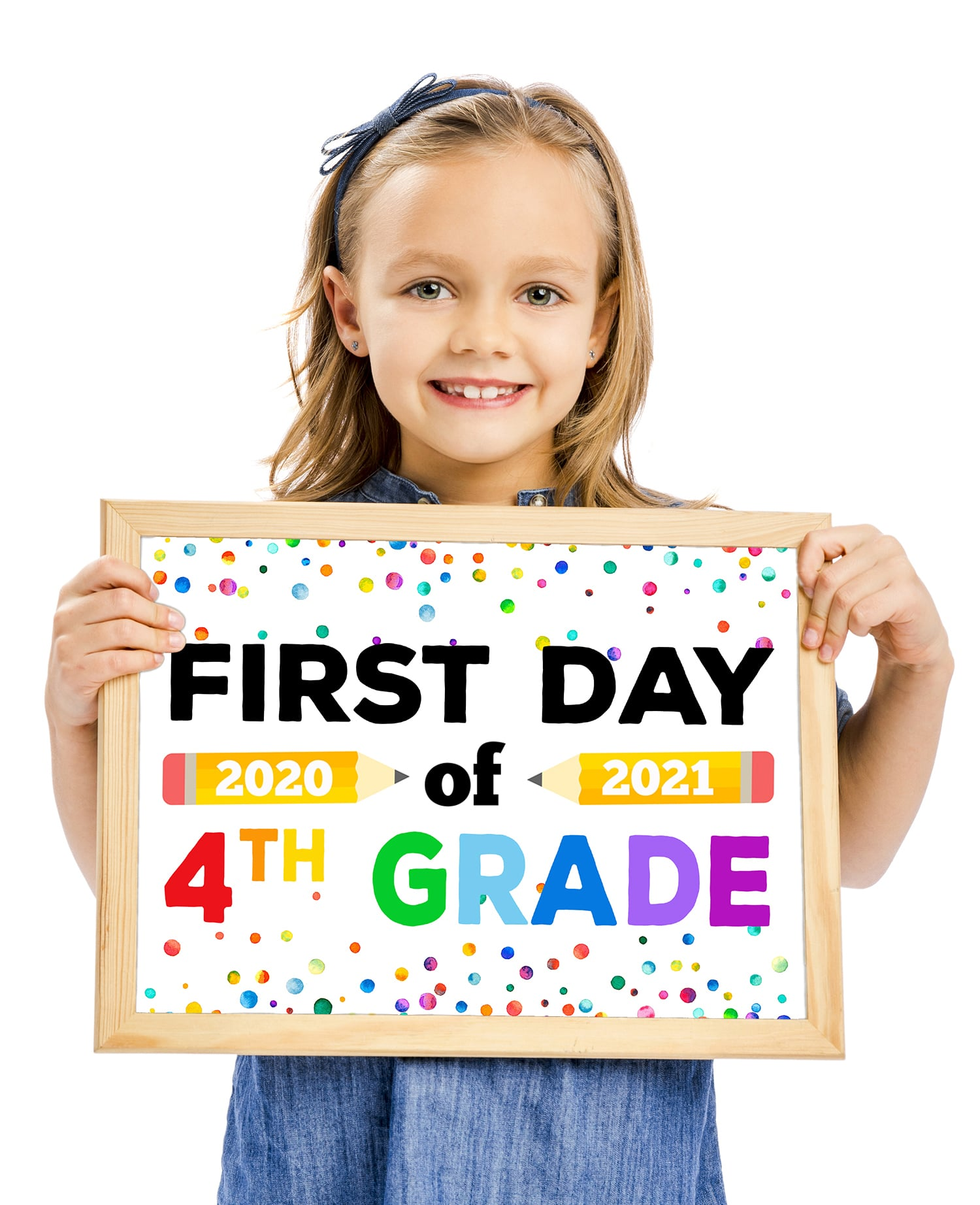 "Cute girl holding a ""First Day of 4th Grade 2020"" sign"