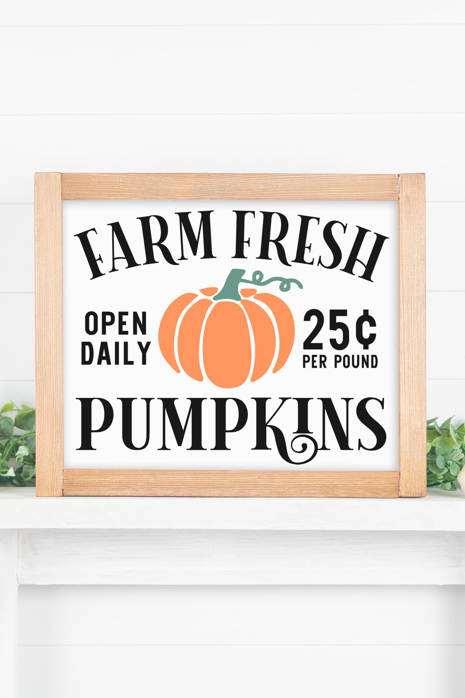 """Farm Fresh Pumpkins"" sign with wood frame on white mantel"