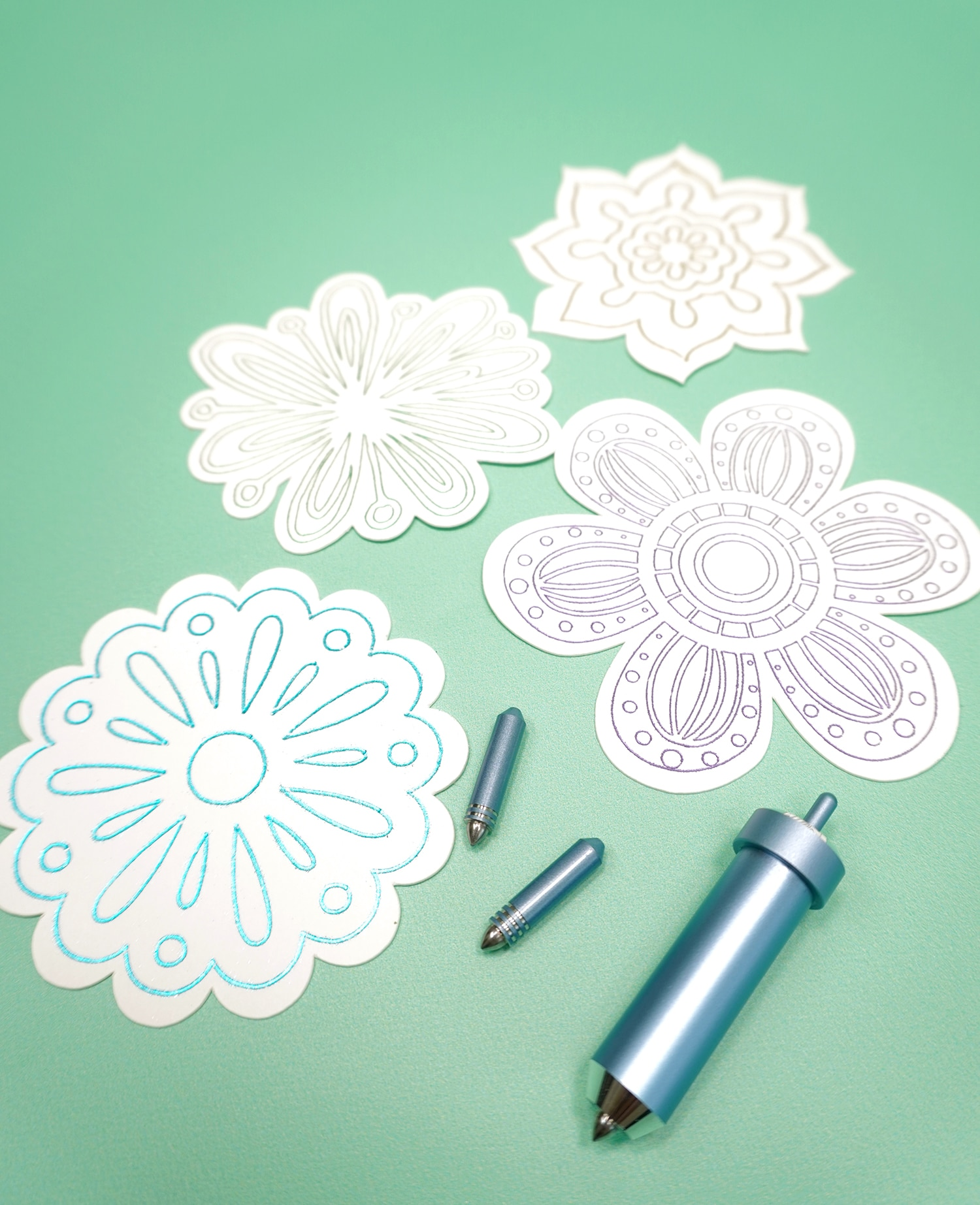 Cricut Foil Transfer Tools and Tips with white foil embellished flower die cuts on mint green background