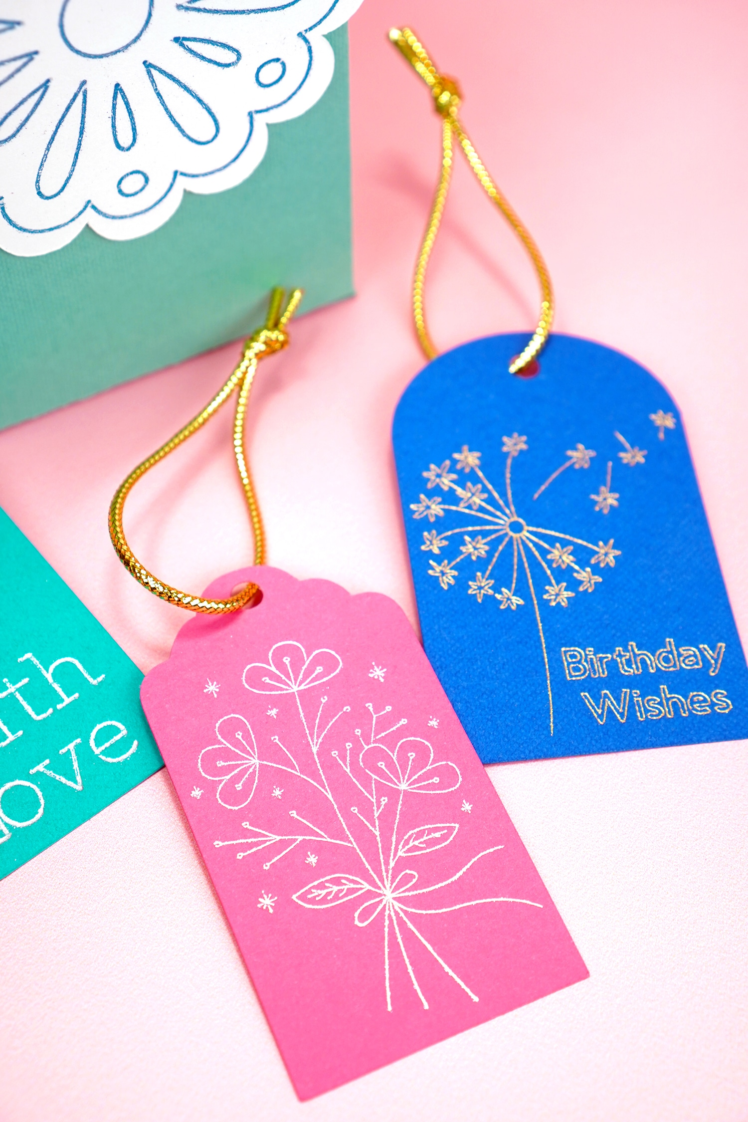 pink and blue foil embellished gift tags on coral background