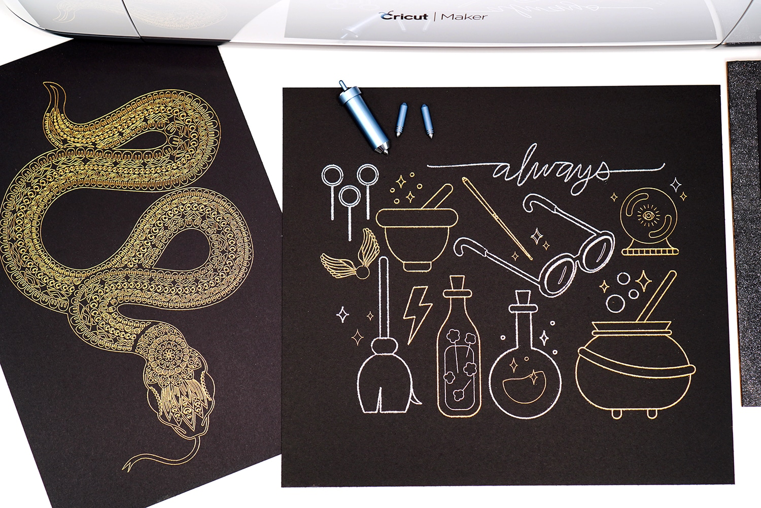 Cricut Maker machine with gold and silver foil art prints (snakes and wizardry) with Cricut Foil Transfer Tool and Tips