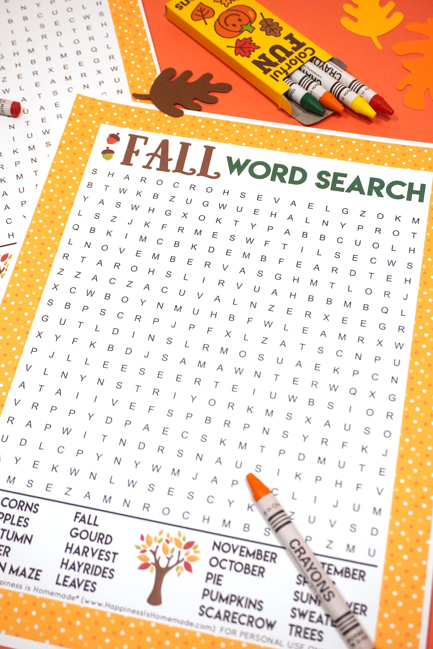 Fall Word Search Printable on dark orange background with orange crayon surrounded by paper leaves
