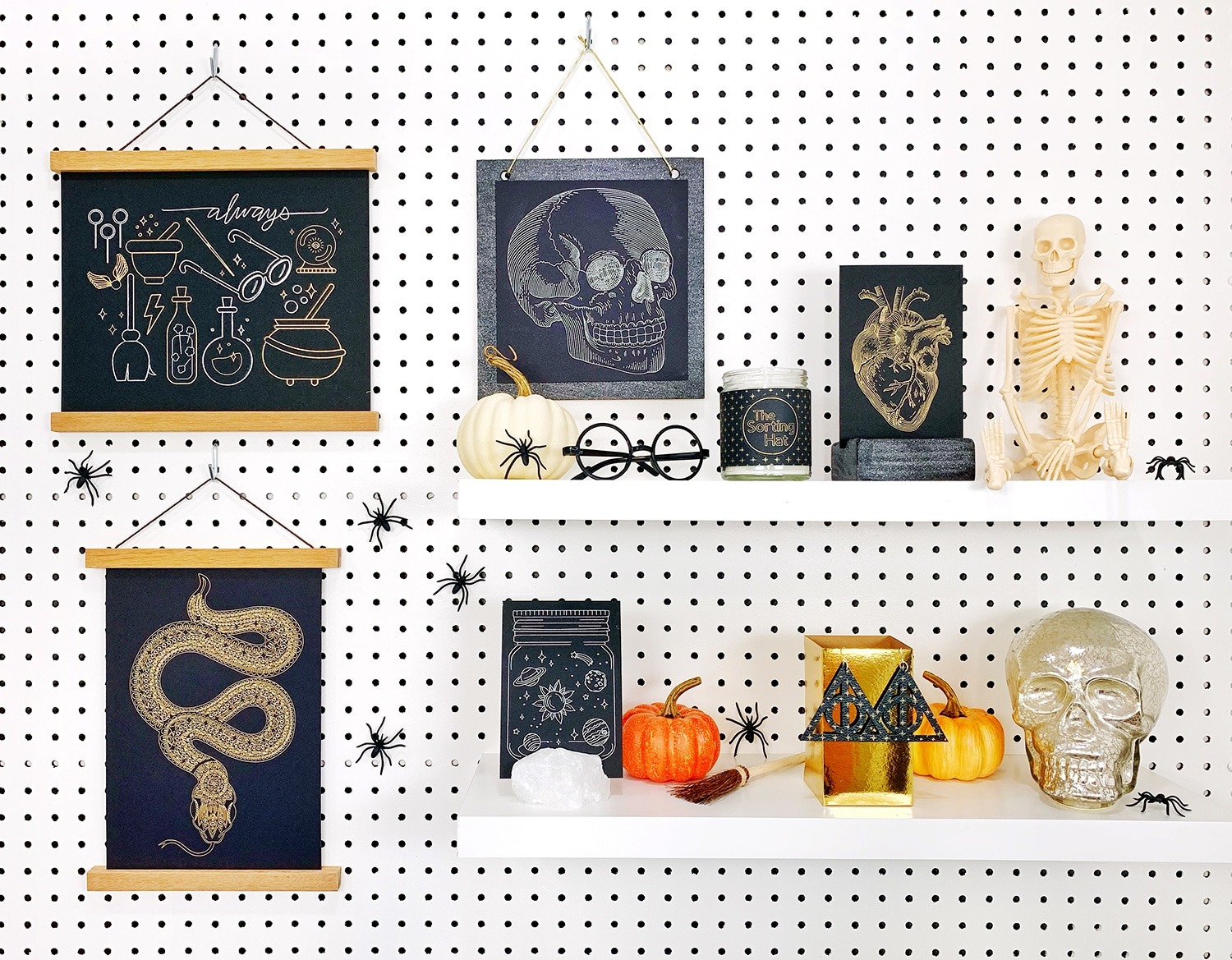 Shelves decorated with Halloween props and Halloween foil art prints