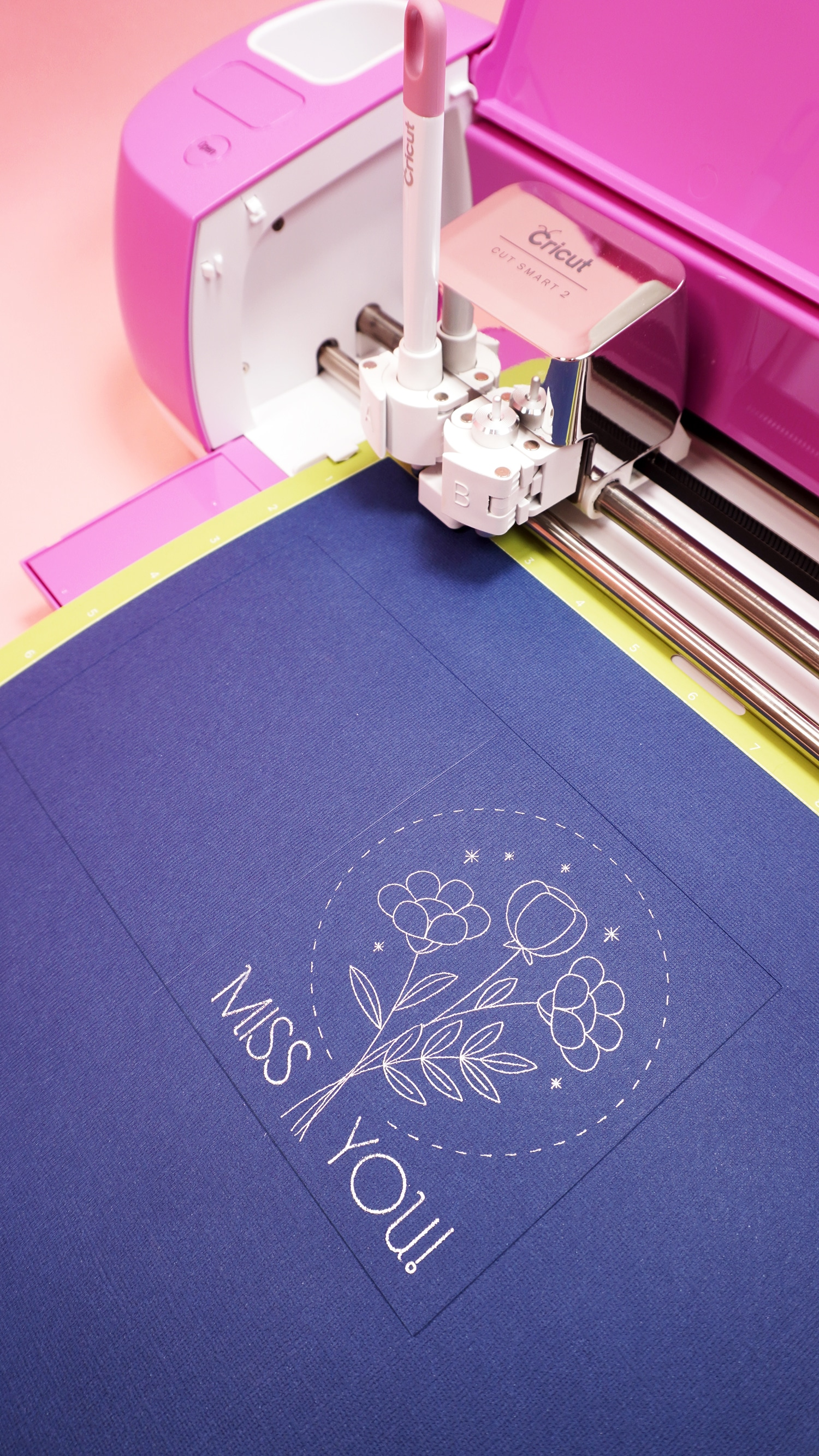 """Navy blue """"Miss You"""" card on mat in pink Cricut Explore Air 2 machine"""