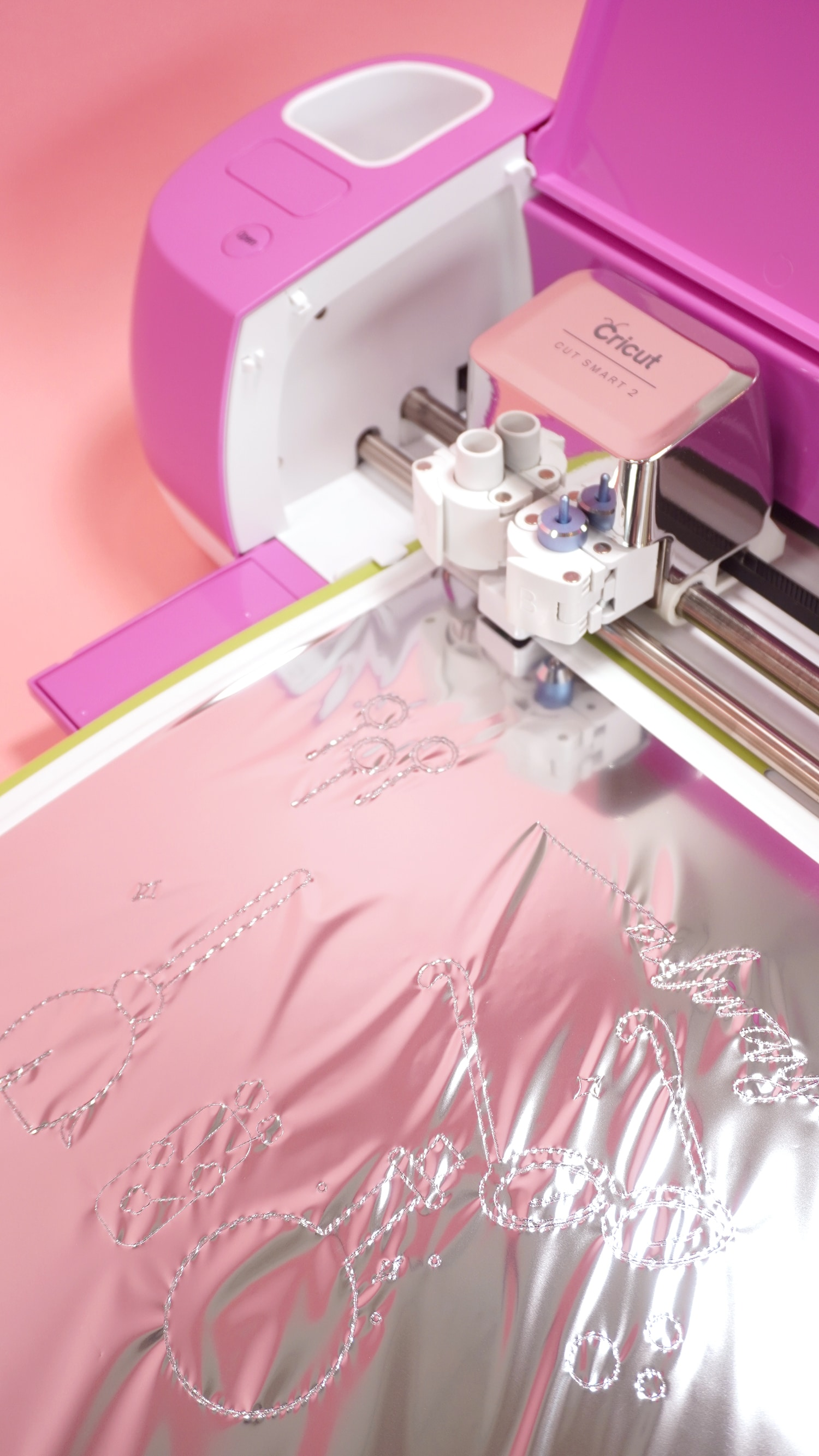 Transferring Silver Foil with Cricut Foil Transfer System on a fuchsia Explore Air 2 machine