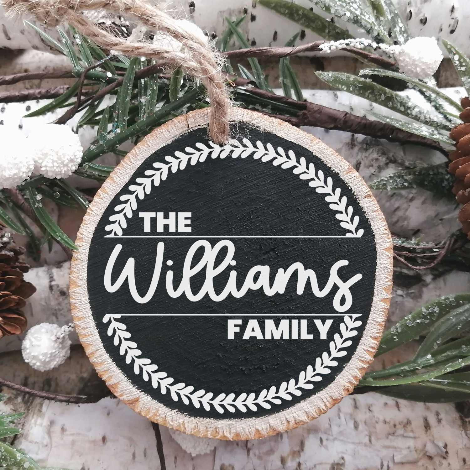 "Chalkboard painted wood slice Christmas ornament with ""The Williams Family"" and wreath design"