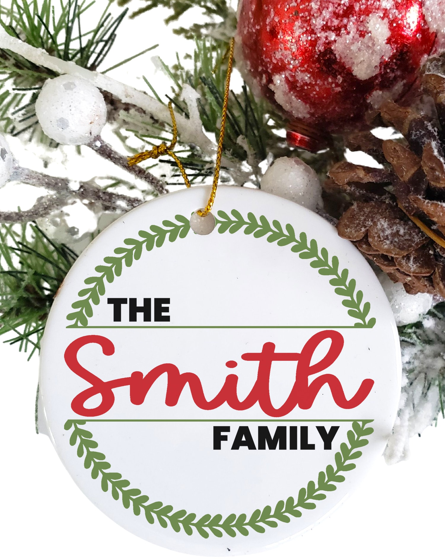 "Round white Christmas ornament with ""The Smith Family"" and wreath design in red and green"