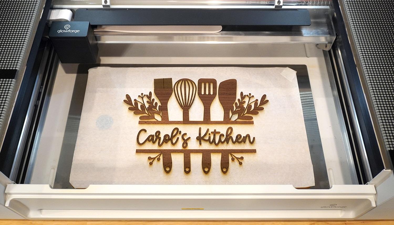 "Freshly Engraved ""Carol's Kitchen"" Cutting Board in Glowforge Pro"