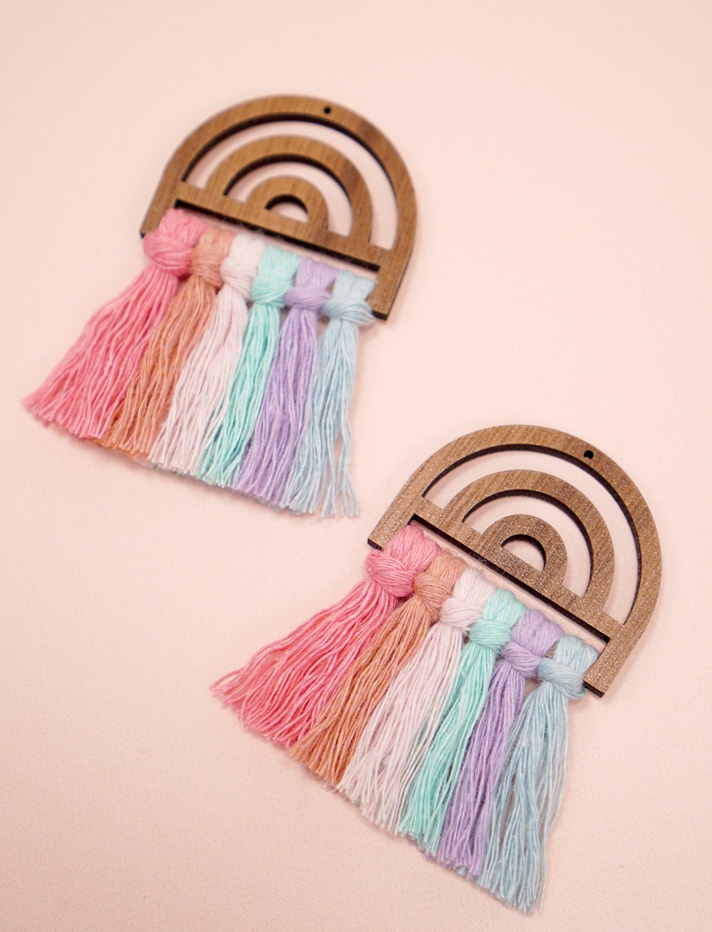 pastel wooden rainbow macrame earrings on peach background