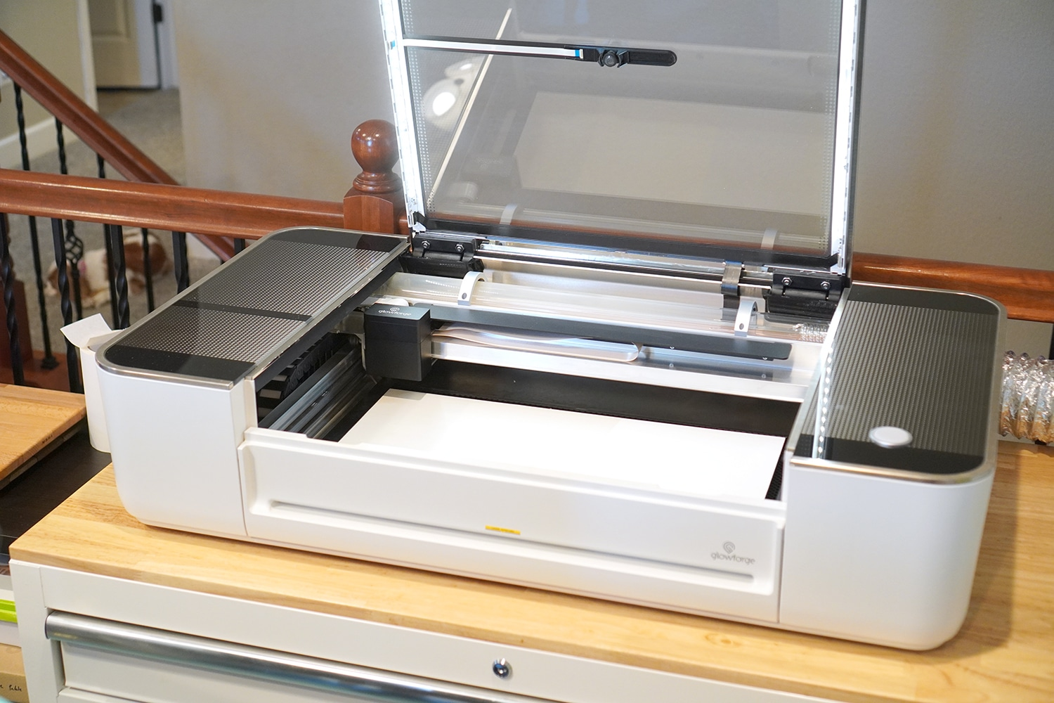 Open Glowforge Pro on work bench with Masked Wood Inside