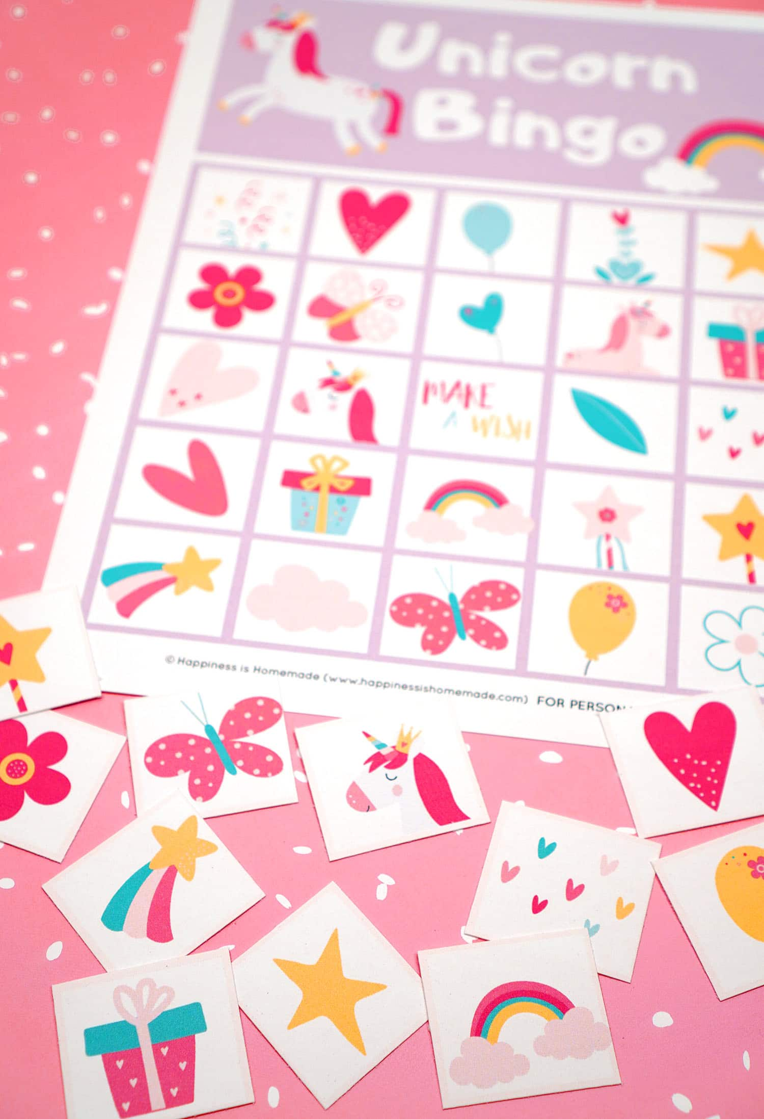 Printable Unicorn Bingo Game Cards and calling cards on pink background with