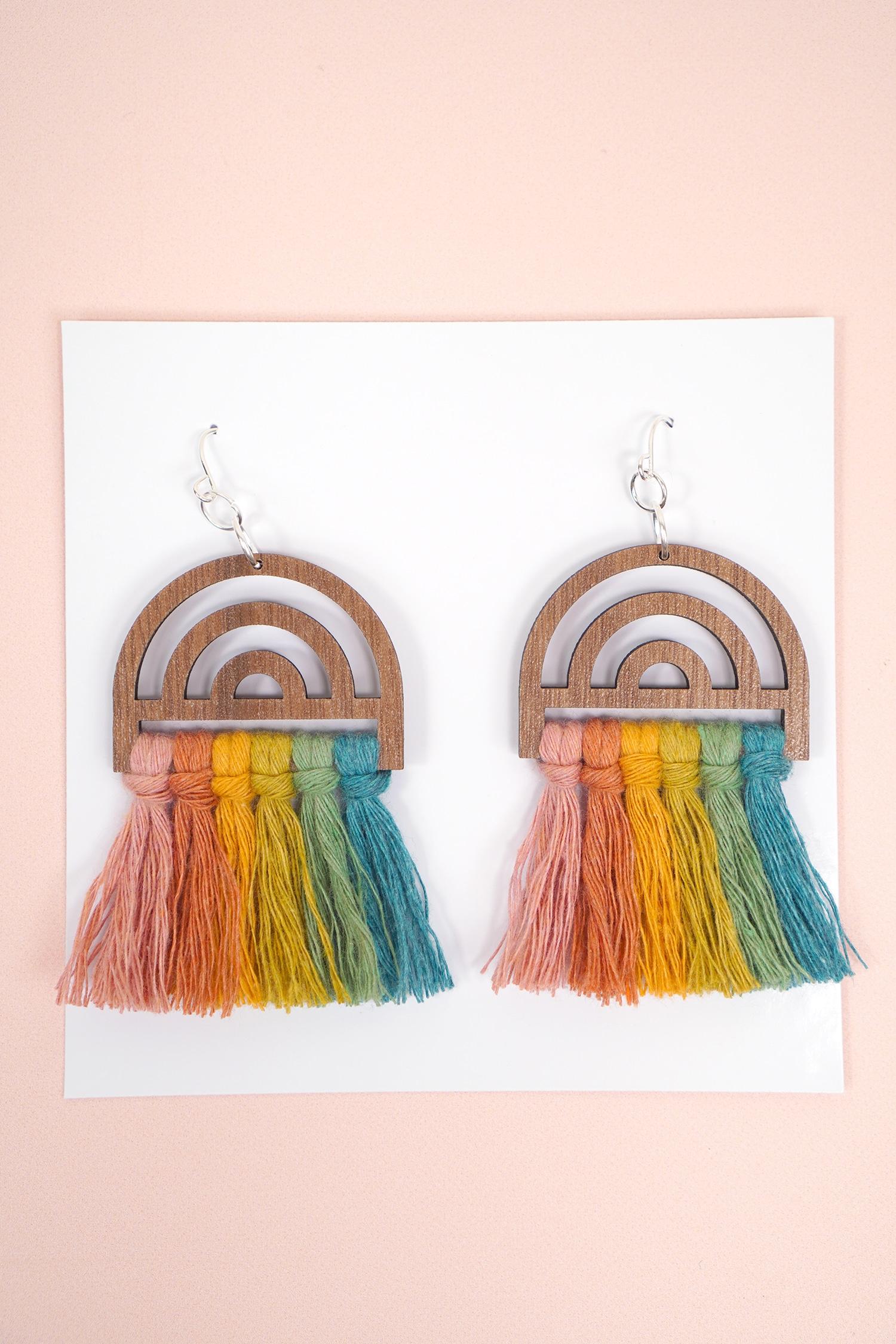 Wooden Rainbow Macrame Earrings on Peach Background