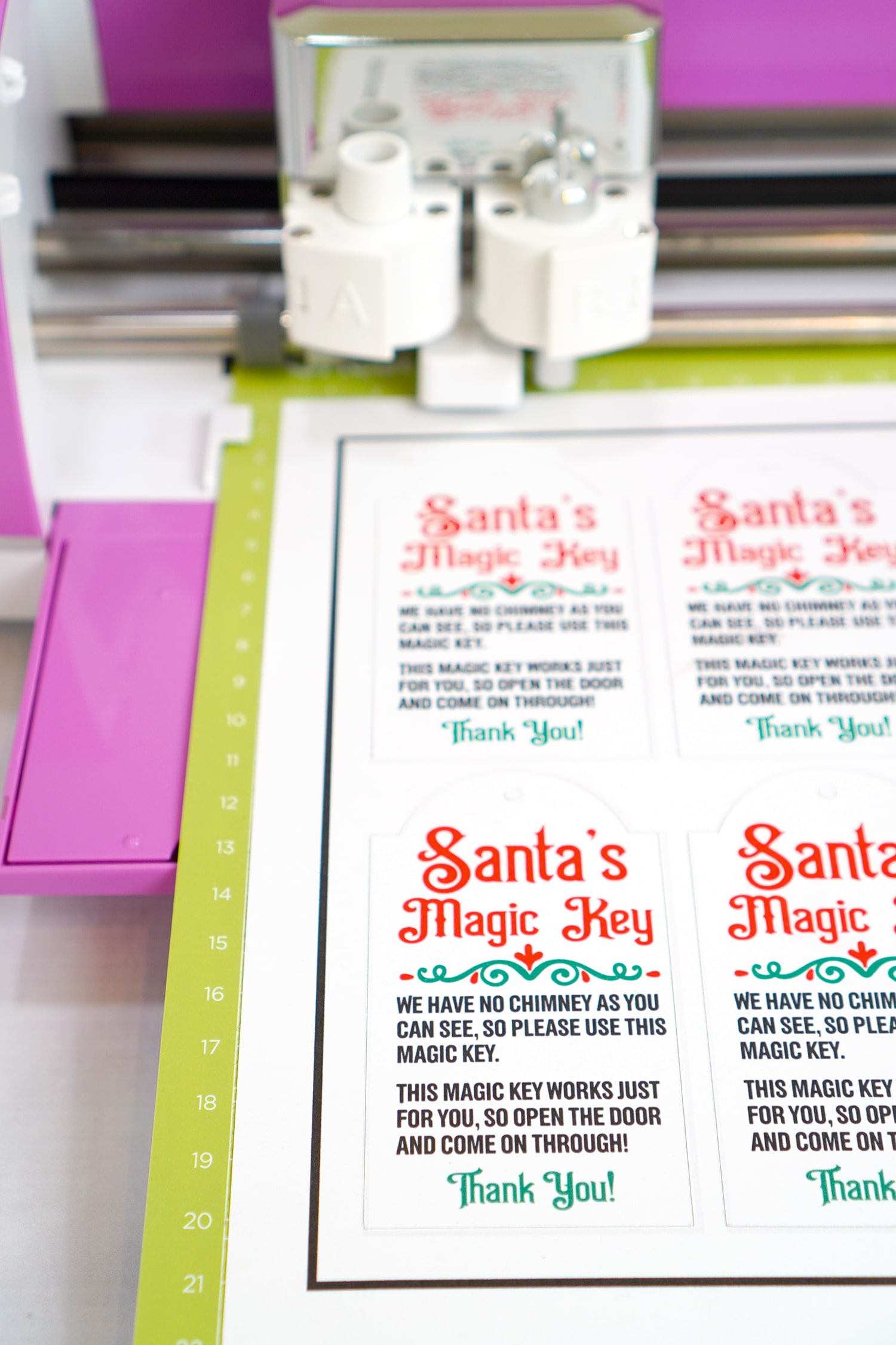 Close up of Santa's Magic Key printables on green Cricut mat