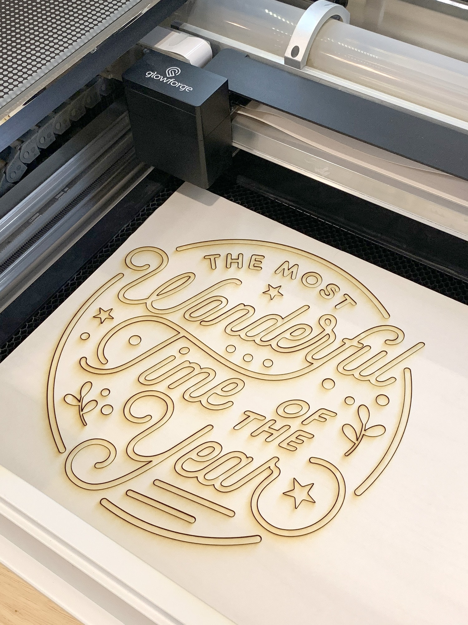 """The Most Wonderful Time of the Year"" Christmas Sign Pieces in Glowforge Machine"