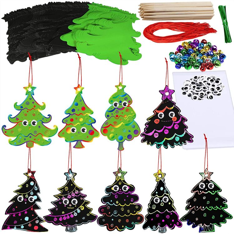 Christmas Crafts for Kids: Scratch art Christmas trees with jingle bells, googly eyes, and accessories on a white background