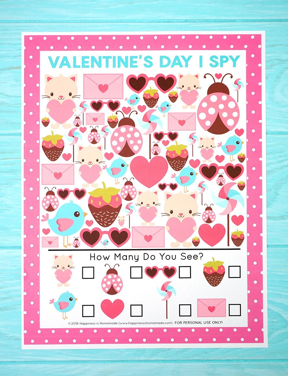 Valentine's Day I Spy Game on blue wood background