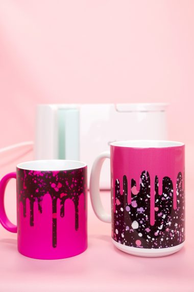 "Two ""Drippy"" pink and black mugs with the Cricut Mug Press"