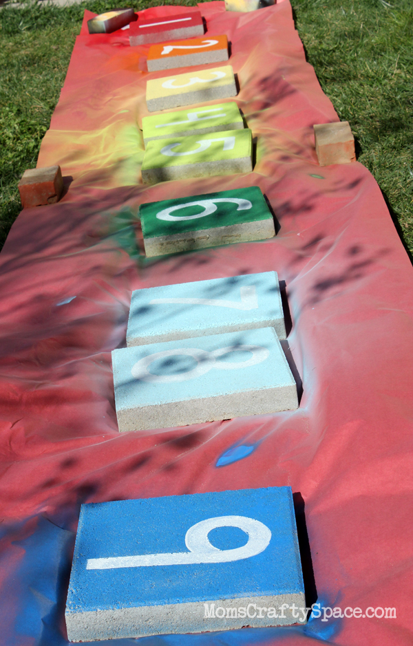 I Laid Out A Big Sheet Of Red Kraft Paper To Protect The Lawn, And Then  Sutton And I Spray Painted The Tops Of 12u2033 Garden Pavers In Our Rainbow  Palette Of ...
